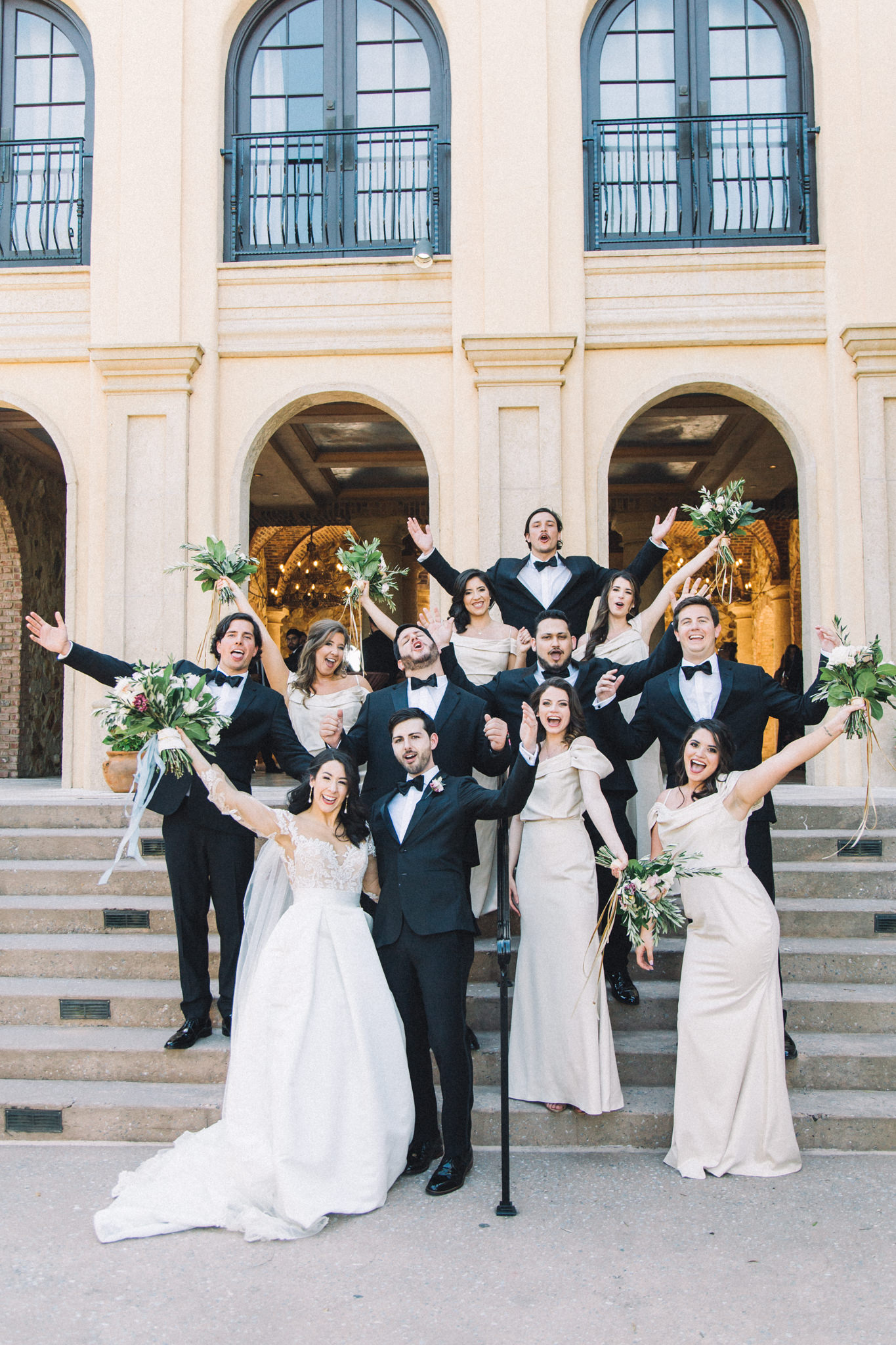 entire bridal party portraits with bouquets and bowties