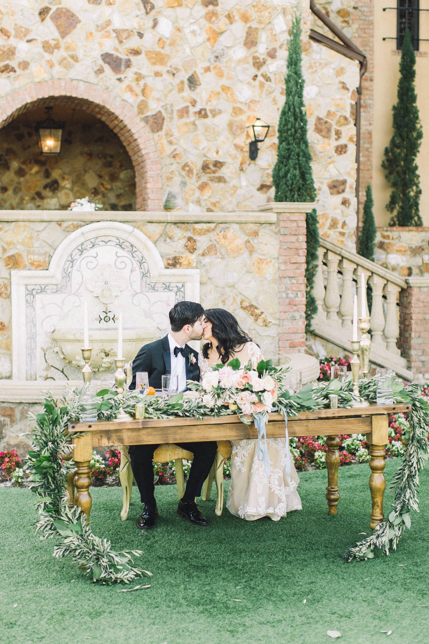 luxury wedding photographer bride with groom head table
