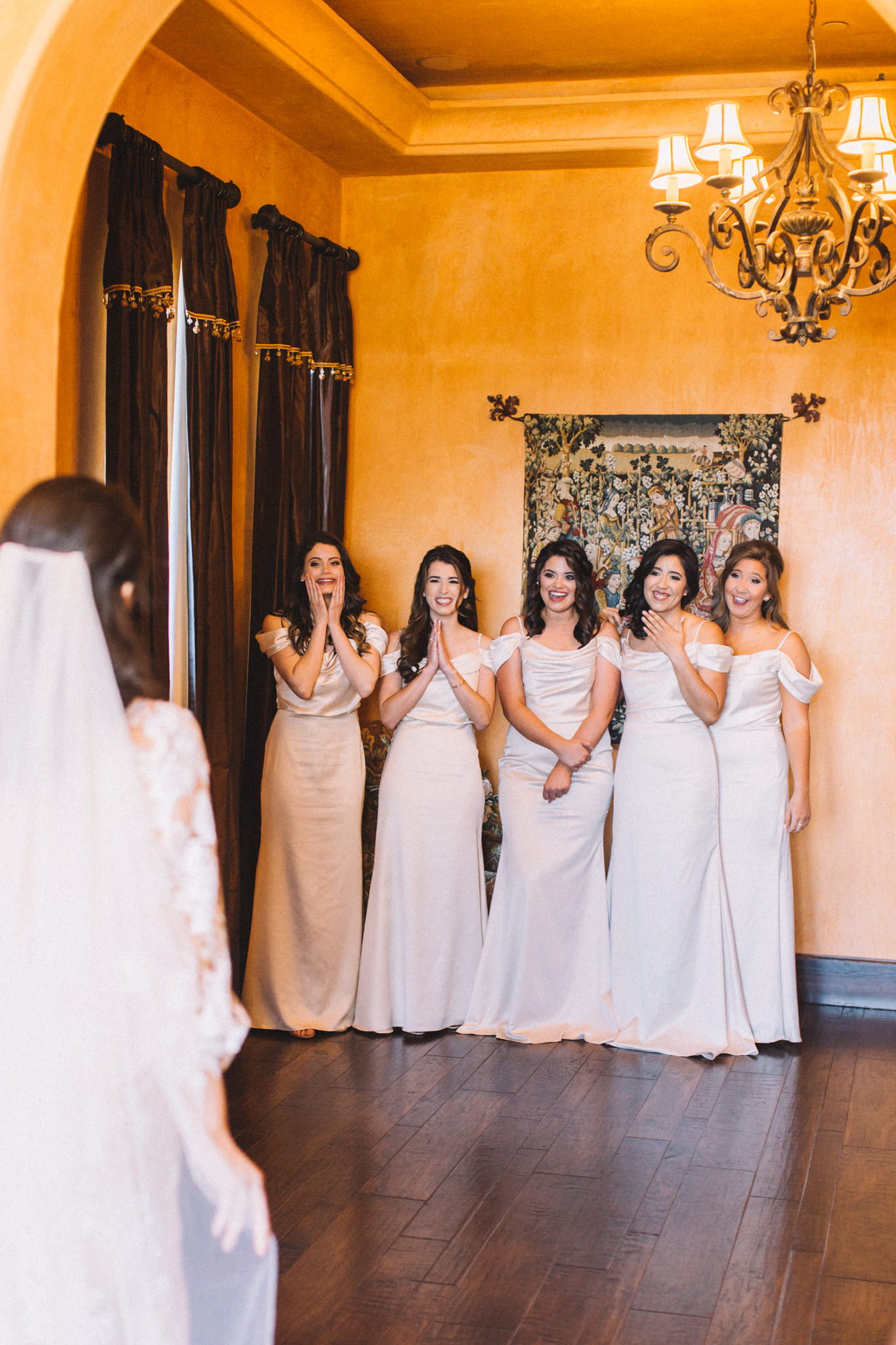 bride with bridesmaids first look