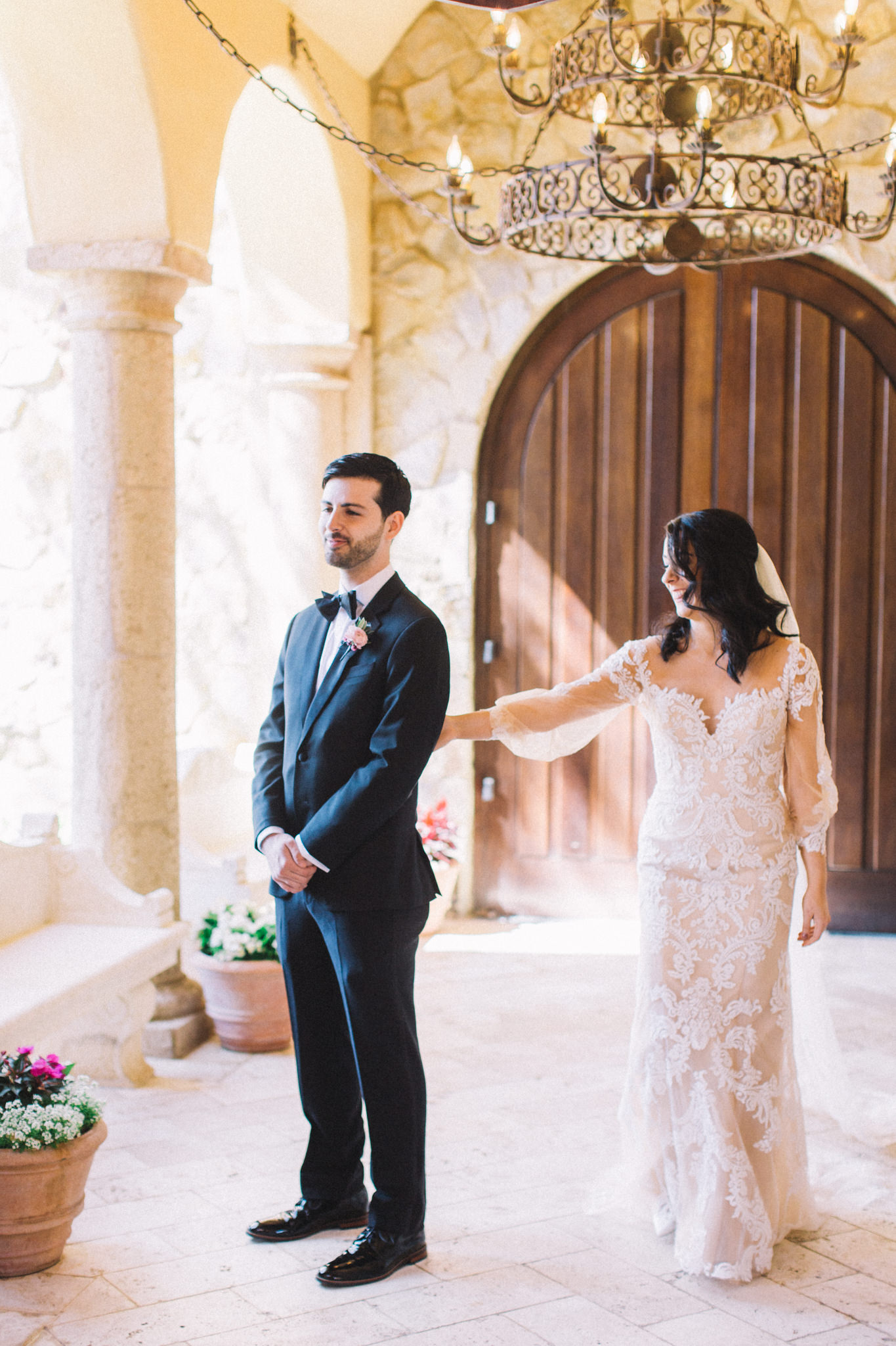 first look bride with groom at outdoor luxury wedding