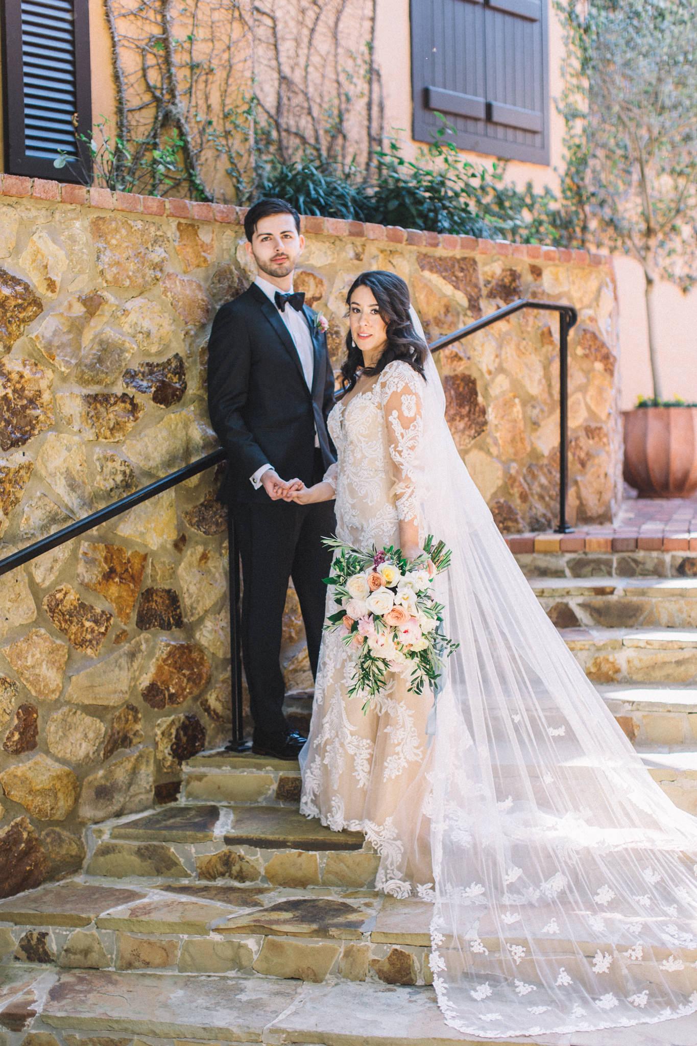 bride with groom professional portraits in bridal attire